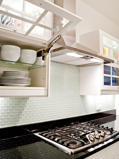 Example Of A Trendy Kitchen Design In DC Metro With Glass Front Cabinets,  White