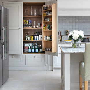 Kitchen - transitional kitchen idea in London with shaker cabinets, gray cabinets, granite countertops, gray backsplash and stainless steel appliances