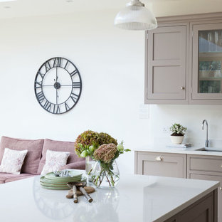 Large classic open plan kitchen in London with shaker cabinets and an island.
