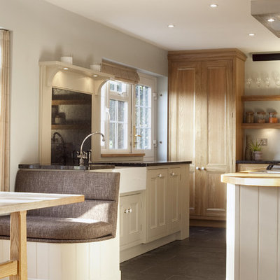 Kitchen - traditional kitchen idea in London with stainless steel appliances, a farmhouse sink and granite countertops