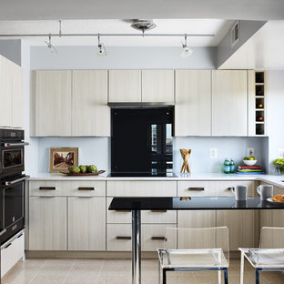 Contemporary kitchen photos - Inspiration for a contemporary l-shaped beige floor kitchen remodel in DC Metro with an undermount sink, flat-panel cabinets, quartz countertops, gray backsplash, glass sheet backsplash, a peninsula, white countertops, beige cabinets and black appliances