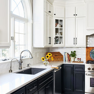 Inspiration for a mid-sized country l-shaped eat-in kitchen in DC Metro with a farmhouse sink, shaker cabinets, white cabinets, quartz benchtops, white splashback, porcelain splashback, stainless steel appliances, porcelain floors, with island, white floor and white benchtop.