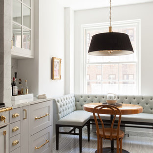 Large traditional eat-in kitchen photos - Large elegant single-wall porcelain floor eat-in kitchen photo in New York with an undermount sink, flat-panel cabinets, gray cabinets, marble countertops, gray backsplash, stone tile backsplash, white appliances and no island