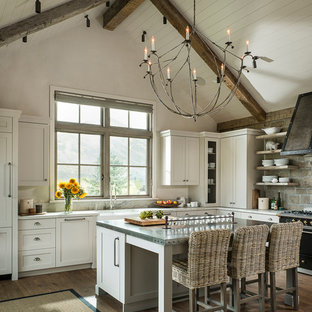 Huge farmhouse kitchen photos - Kitchen - huge country medium tone wood floor kitchen idea in Other with a farmhouse sink, shaker cabinets, stone tile backsplash and an island