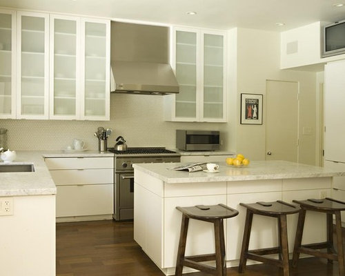 Inspiration For A Transitional Kitchen Remodel In Los Angeles With  Glass Front Cabinets, Stainless