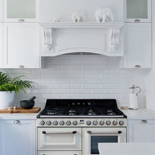 Photo of a traditional kitchen in Perth with shaker cabinets, white cabinets, white splashback, subway tile splashback and white appliances.