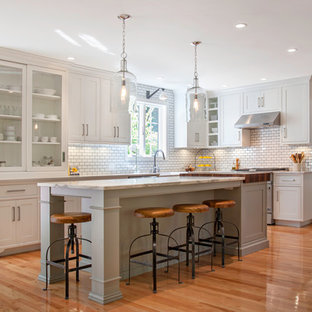 Farmhouse kitchen pictures - Inspiration for a cottage kitchen remodel in Boston with white cabinets, white backsplash, subway tile backsplash and stainless steel appliances