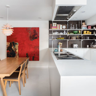 Contemporary eat-in kitchen ideas - Inspiration for a contemporary u-shaped white floor eat-in kitchen remodel in Sacramento with flat-panel cabinets, white cabinets, a peninsula and white countertops