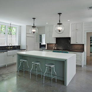 Transitional enclosed kitchen appliance - Transitional concrete floor and gray floor enclosed kitchen photo in Houston with a farmhouse sink, shaker cabinets, white cabinets, black backsplash, colored appliances, an island and soapstone countertops