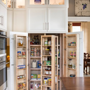 Large country medium tone wood floor enclosed kitchen photo in Atlanta with recessed-panel cabinets, white cabinets, stainless steel appliances and an island