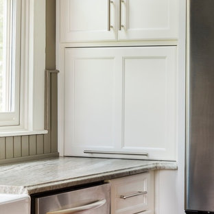 Design ideas for a large country separate kitchen in Atlanta with a farmhouse sink, shaker cabinets, white cabinets, limestone benchtops, green splashback, stainless steel appliances, medium hardwood floors and with island.
