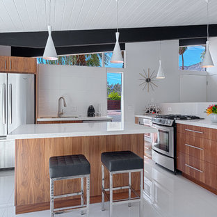 Inspiration for a mid-sized midcentury l-shaped kitchen in Other with an undermount sink, flat-panel cabinets, medium wood cabinets, quartzite benchtops, white splashback, stone slab splashback, stainless steel appliances, ceramic floors and with island.