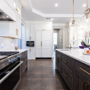 Inspiration for a large transitional u-shaped open plan kitchen in DC Metro with a single-bowl sink, beaded inset cabinets, white cabinets, quartz benchtops, white splashback, ceramic splashback, panelled appliances, dark hardwood floors, with island, brown floor, white benchtop and recessed.