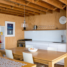 Beach Style Kitchen by Mason & Wales Architects
