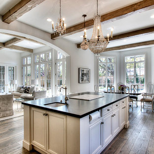 Inspiration for a traditional open plan kitchen in Houston with a single-bowl sink, recessed-panel cabinets, beige cabinets and black benchtop.