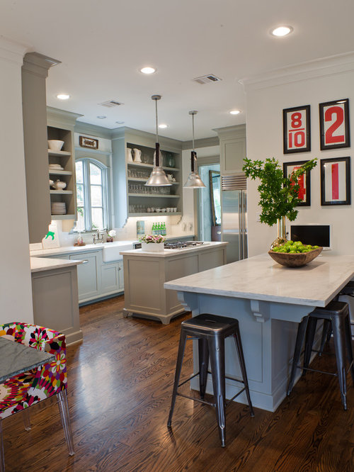 Transitional Kitchen Idea In Houston With A Farmhouse Sink, Stainless Steel  Appliances, Open Cabinets