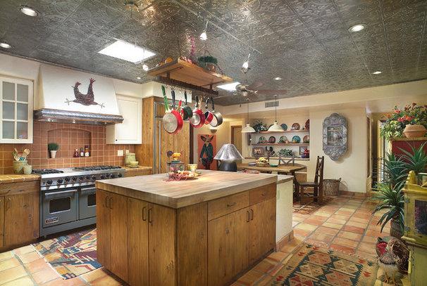 Southwestern Kitchen by Eren Design and Remodel