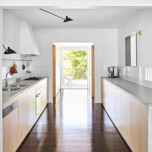 Small contemporary kitchen designs - Inspiration for a small contemporary galley dark wood floor and black floor kitchen remodel in Brisbane with light wood cabinets and concrete countertops