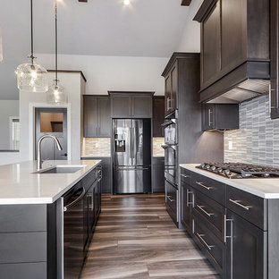 Modern l-shaped eat-in kitchen in Other with an undermount sink, shaker cabinets, grey cabinets, quartz benchtops, multi-coloured splashback, mosaic tile splashback, stainless steel appliances, vinyl floors, with island, grey floor and white benchtop.