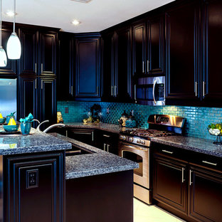 Mid-sized transitional kitchen pantry ideas - Inspiration for a mid-sized transitional l-shaped porcelain tile kitchen pantry remodel in Las Vegas with an undermount sink, raised-panel cabinets, black cabinets, granite countertops, blue backsplash, glass tile backsplash, stainless steel appliances and an island