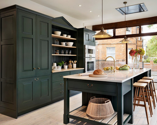 Elegant Traditional Galley Kitchen Idea In Oxfordshire With Recessed Panel Cabinets,  Green Cabinets, Stainless