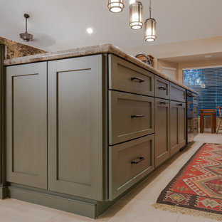 Large arts and crafts galley eat-in kitchen in Phoenix with a double-bowl sink, shaker cabinets, medium wood cabinets, granite benchtops, red splashback, ceramic splashback, black appliances, porcelain floors, with island, beige floor and green benchtop.