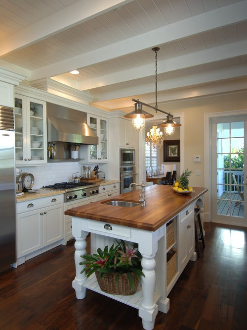 Example Of A Mid Sized Classic Galley Dark Wood Floor Enclosed Kitchen Design In Miami