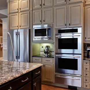 Kitchen - traditional kitchen idea in Atlanta with raised-panel cabinets, gray cabinets and stainless steel appliances