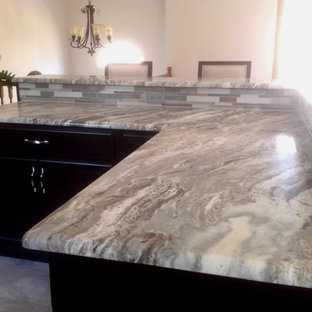 Inspiration for a mid-sized beach style l-shaped eat-in kitchen in New York with black cabinets, quartzite benchtops, multi-coloured splashback, subway tile splashback, ceramic floors and with island.