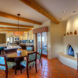 Large southwestern eat-in kitchen remodeling - Inspiration for a large southwestern l-shaped terra-cotta floor eat-in kitchen remodel in Phoenix with a farmhouse sink, shaker cabinets, dark wood cabinets, recycled glass countertops, blue backsplash, ceramic backsplash, stainless steel appliances and an island