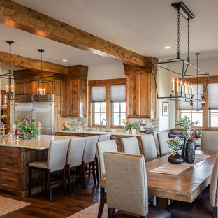 Inspiration for a country eat-in kitchen in Other with recessed-panel cabinets, medium wood cabinets, multi-coloured splashback, stainless steel appliances, dark hardwood floors, with island and beige benchtop.
