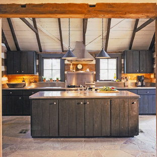 Rustic kitchen designs - Inspiration for a rustic kitchen remodel in Austin with stainless steel appliances