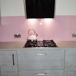Textured concrete effect kitchen with baby pink accents