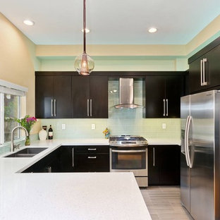 Small contemporary eat-in kitchen pictures - Eat-in kitchen - small contemporary u-shaped porcelain floor eat-in kitchen idea in San Diego with a double-bowl sink, flat-panel cabinets, dark wood cabinets, quartz countertops, glass tile backsplash, stainless steel appliances and a peninsula