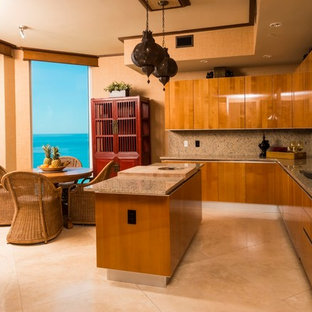Expansive asian u-shaped kitchen in Miami with an undermount sink, flat-panel cabinets, medium wood cabinets, granite benchtops, stone slab splashback, stainless steel appliances, marble floors and with island.