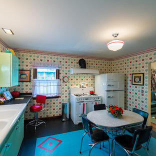 Mid-sized midcentury l-shaped separate kitchen in Seattle with a double-bowl sink, louvered cabinets, green cabinets, yellow splashback, linoleum floors and no island.