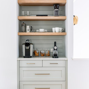 Design ideas for a nautical kitchen pantry in New York with shaker cabinets, blue cabinets, engineered stone countertops, blue splashback, wood splashback, light hardwood flooring and white worktops.