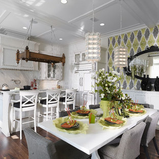 Design ideas for a large tropical single-wall eat-in kitchen in Tampa with recessed-panel cabinets, distressed cabinets, white splashback, stone slab splashback, an undermount sink, marble benchtops, panelled appliances, dark hardwood floors, with island and brown floor.