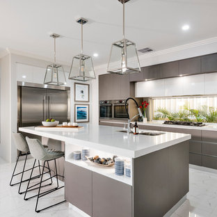 This is an example of a large contemporary galley open plan kitchen in Perth with an undermount sink, flat-panel cabinets, dark wood cabinets, quartz benchtops, stainless steel appliances, porcelain floors, with island, white floor and window splashback.