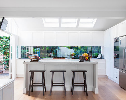 This Is An Example Of A Mid Sized Transitional L Shaped Kitchen In Sydney
