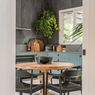 Mid-sized contemporary l-shaped eat-in kitchen in Sydney with an undermount sink, flat-panel cabinets, green cabinets, quartz benchtops, grey splashback, slate splashback, stainless steel appliances, painted wood floors, white floor and grey benchtop.