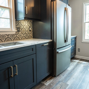 Inspiration for a small modern galley separate kitchen in Atlanta with an undermount sink, shaker cabinets, blue cabinets, quartz benchtops, multi-coloured splashback, porcelain splashback, coloured appliances, vinyl floors, no island, multi-coloured floor and grey benchtop.