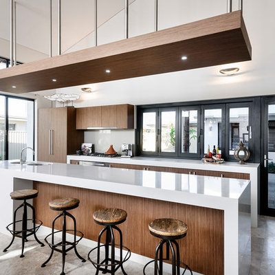 Large trendy galley kitchen photo in Perth with flat-panel cabinets, dark wood cabinets, paneled appliances, an island, a double-bowl sink, quartzite countertops, gray backsplash and glass sheet backsplash