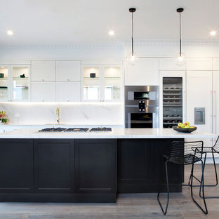 Photo of a large transitional galley kitchen in Melbourne with a single-bowl sink, shaker cabinets, yellow cabinets, quartz benchtops, yellow splashback, stone slab splashback, stainless steel appliances, medium hardwood floors and with island.