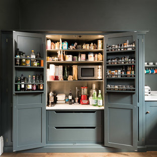 Classic kitchen pantry in London with shaker cabinets and grey cabinets.