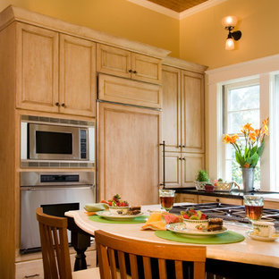 Traditional kitchen designs - Example of a classic kitchen design in Jackson with paneled appliances