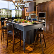 Eclectic Kitchen by the bohemian kitchen of Gozan Interiors