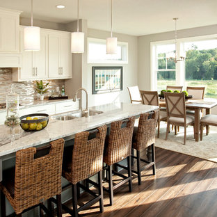Transitional eat-in kitchen photo in Minneapolis with a double-bowl sink, shaker cabinets, white cabinets, granite countertops, multicolored backsplash, matchstick tile backsplash and gray countertops