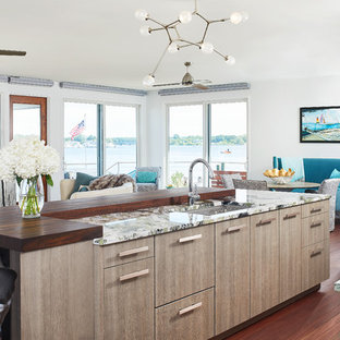 Beach style kitchen appliance - Example of a coastal kitchen design in Grand Rapids