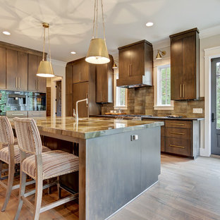 Mid-sized modern open concept kitchen ideas - Mid-sized minimalist l-shaped medium tone wood floor and brown floor open concept kitchen photo in Other with an undermount sink, flat-panel cabinets, dark wood cabinets, brown backsplash, ceramic backsplash, stainless steel appliances, an island and brown countertops